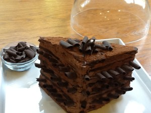I used Gezine Bullock-Prado's chocolate pyramid recipe but added a twist:  chocolate mega curls protrude from the triangular cut of this 8 layaer cake!